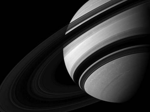 Dwarfed by Saturn Saturn's moon Mimas appears near Saturn, dwarfed by its parent planet in this image. Mimas (246 miles, or 396 kilometers across) appears tiny compared to the storms clearly visible in far northern and southern hemispheres of Saturn. This view looks toward the unilluminated side of the rings from about 18 degrees below the ringplane. North on Saturn is up and rotated 27 degrees to the left.