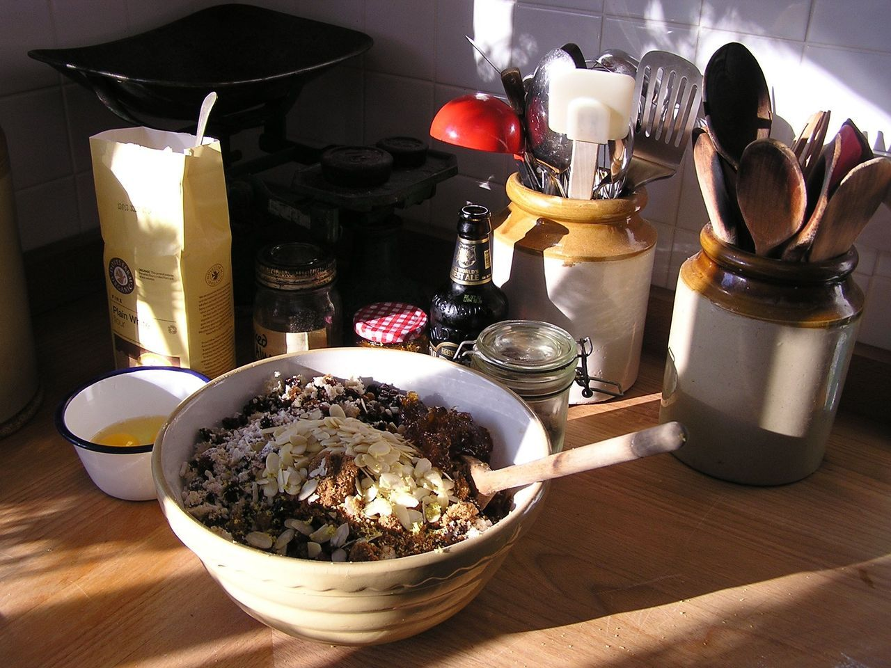 Today is Stir Up Sunday, the traditional day for making Christmas puddings. After a lengthy boiling, the puddings need to mature for several weeks so now's about the right time. I'm also making a cake for Christmas later too; I don't always stick to the traditional day, in fact I often make them a few weeks earlier as both improve with keeping. I'm making two puddings today, one for Christmas and one for later in the winter as something to come back to after a days digging on the allotment or a long walk. The recipe I'm using is one from Hugh Fearlessly-Eatingall, as he's known in the Greedy Gardener household, and as well as the bottle of stout and breadcrumbs favoured by my grandmother, it also uses marmalade which I've found to be a most delicious addition. I've replaced some of the vine fruits with a few chopped prunes as well for extra moistness. If you don't have an enormous tribe to feed at Christmas, I've made this recipe with half the amounts in smaller basins and it works perfectly well. The name Stir Up Sunday has its origins in church tradition. Today is the last Sunday before Advent, and the collect for the day begins with the words: Stir up, we beseech thee, O Lord, the wills of thy faithful people; that they, plenteously bringing forth the fruit of good works, may of thee be plenteously rewarded.  I am indeed bringing forth plenteous fruit for the recipe, and whether or not this is the kind of fruit that the Book of Common Prayer had in mind, I expect to be plenteously rewarded on Christmas day.