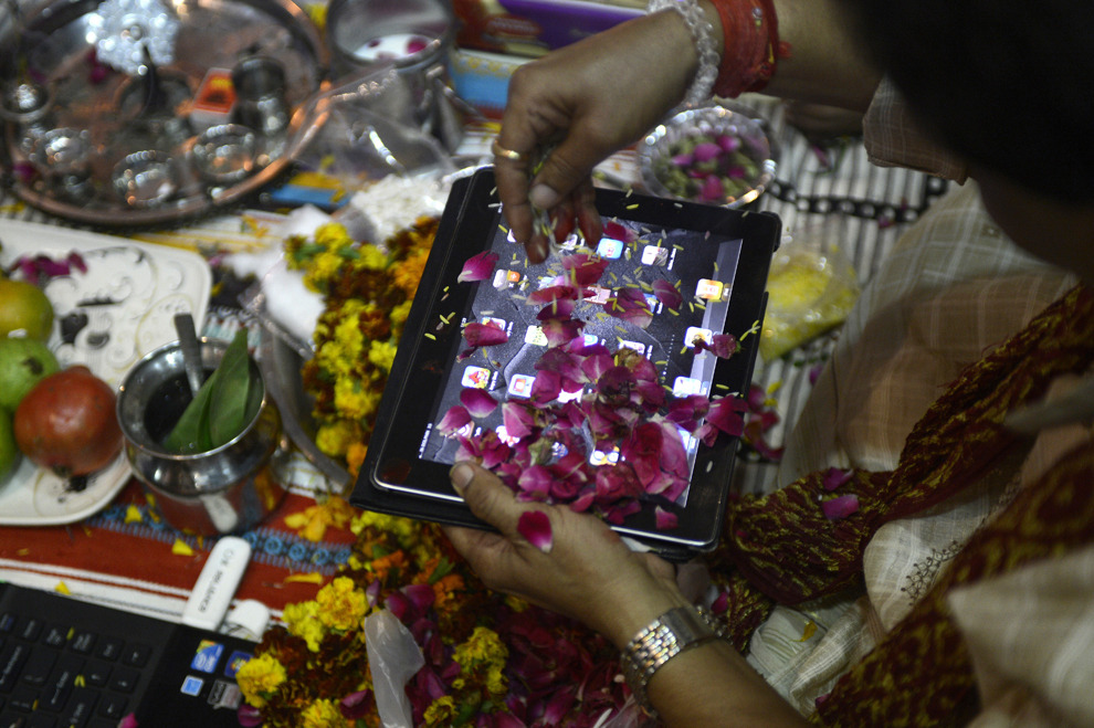 An Indian trader worships an iPad during Diwali, Sajjad Hussain/AFP/Getty Images.
