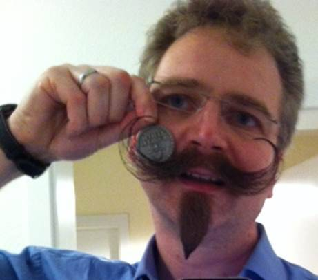 "Konrad Hecker, former beard champion from Germany with his Beard Token, and glorious moustache. REMINDER: This is the last day for 25% off all Beard Token Orders.  Use discount code, ""THANKS""."