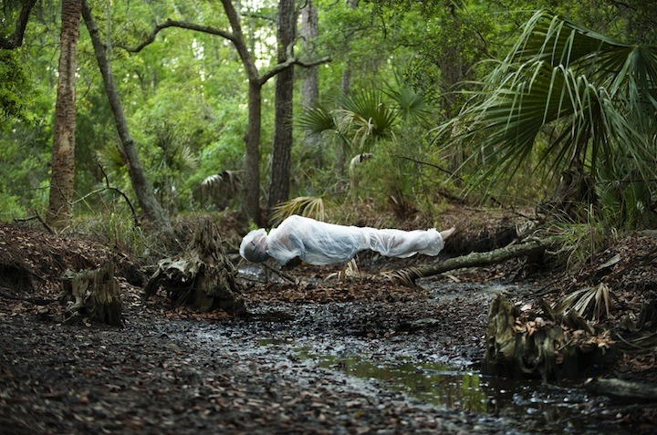 Floating series Photographer Andrew Brodhead grew up in Savannah, Georgia, where he worked at his parent's health food store and as a kid his daily job was to take out the recycling. This is where he recognized how much of the stuff he threw out wasn't recyclable. He began to think about landfills and where everything goes. In his words: 'There are islands of plastic taking over the oceans, the earth is suffocating from plastic that never biodegrades and our water and environment are leaching toxic estrogenic compounds.' With his slightly disturbing 'Floating Series', where you can't help but think of floating corpses wrapped in plastic, he wants to raise awareness for this overwhelming waste we produce everyday. 'Visually, I want to convey the sacrifice we have made by our consumption and waste. The wrapped bodies represent invasive cocoons floating over vulnerable landscapes'. His pictures leave, despite their fragile beauty, a slightly bitter aftertaste.