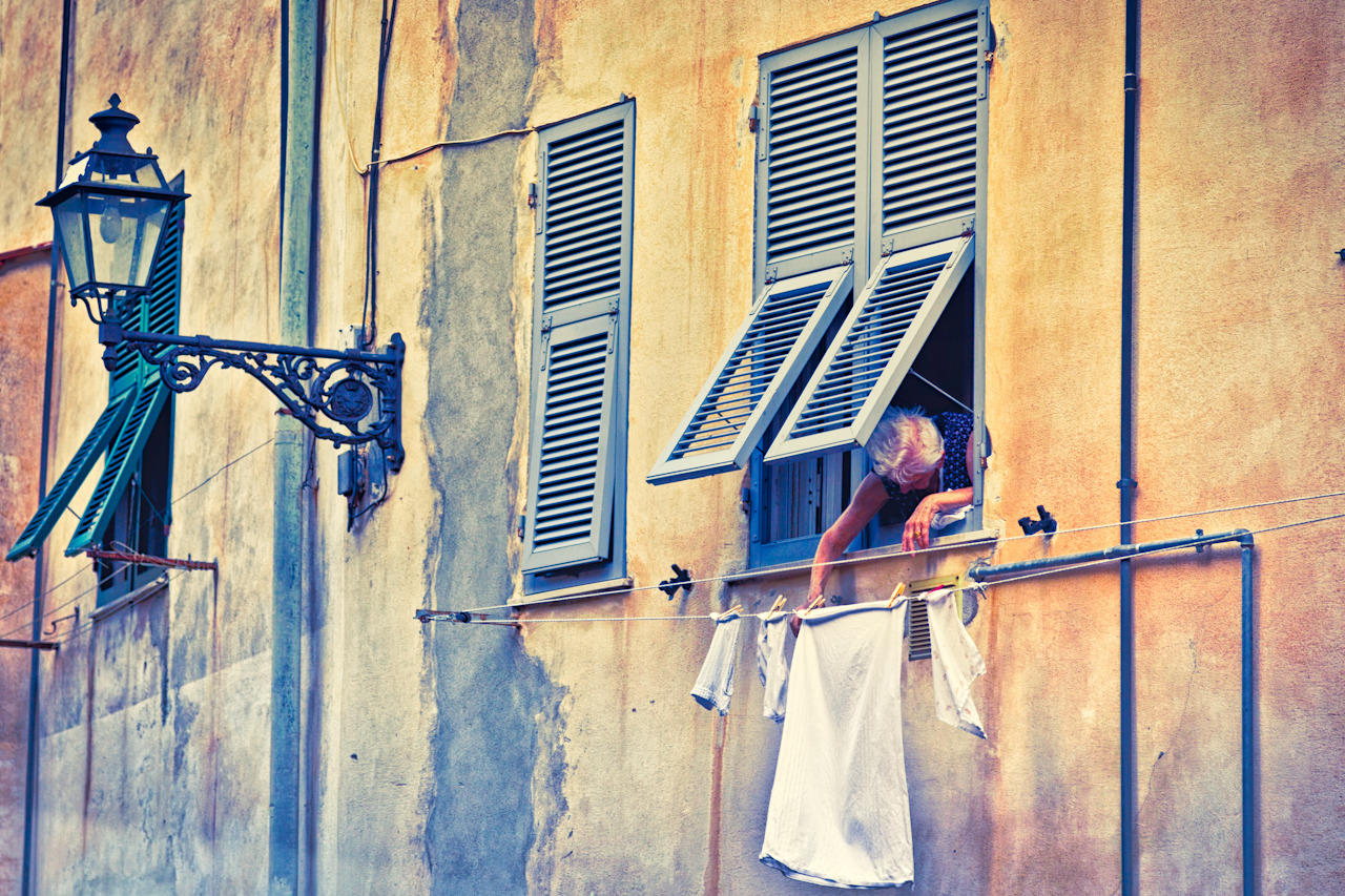 Laundry time in Tuscany on Flickr. It is a lazy afternoon, in a small village in Tuscany. This elderly woman hangs her laundry on a pulley system as she has probably done for decades.