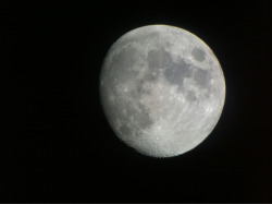 Took a picture of the moon with the camera on my phone through my telescope :)