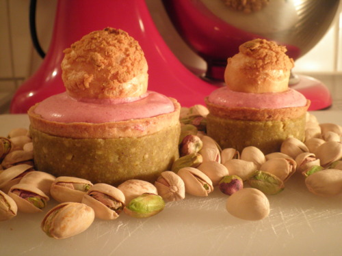 Pistachio sour cherry tart My inspiration for this tart comes from Thomas Haas, Vancouver. The best tart I ever ate, honestly, was the pistachio and sour cherry tart from his shop. I was lucky enough to do a stage at his patisserie a year ago. What an amazing team and such an organized kitchen. So now it is time for my own version of this tart! The tart is made with a shortbread crust and filled with a Morello sour cherry mousse. The mousse is made with an Italian meringue and whipped cream. In the middle is a Morello cherry insert to add a pungent flavour to the tart. On top a profiterole filled with Morello cherry mousse. The profiteroles are baked with pistachio streusel on top.  At the end I wrapped a line of homemade pistachio marzipan around the tart.