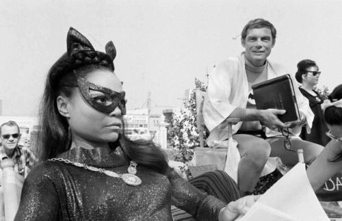Behind-the-scenes photo of Eatha Kitt, & Adam West on the Batman set (1966)