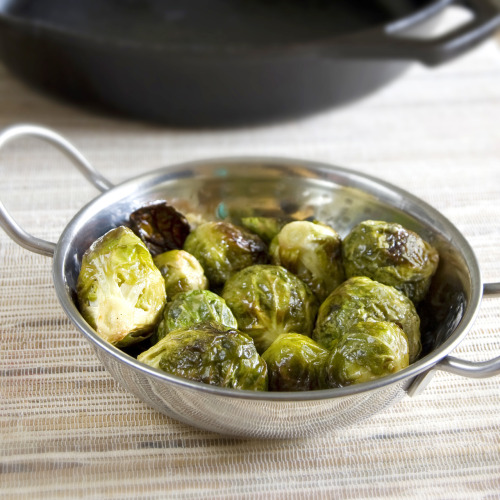 oooeygooeygoodness:  Honey Dijon Brussel Sprouts Ingredients2 cups brussels sprouts2 Tbsp. olive oil1 Tbsp. dijon mustard1 Tbsp. honeysalt and pepper to tatse Directions:Preheat oven to 400. Whisk together olive oil, mustard and honey until well combined. In a large bowl, toss brussels sprouts in honey mustard mixture. Spread brussels sprouts evenly on a cast iron skillet or roasting pan. Salt and pepper to taste. Bake on top rack for 20 minutes. Remove from oven and toss so the brussels sprouts cook evenly. Place back in the oven and roast for an additional 10 minutes. The outside leaves should be slightly charred and the inside should be tender. Source: Mine!!!