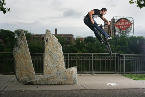 Nick AndersonTurndown – Minneapolis, MN This shot is actually from a couple years ago when Nick was riding for Eastern and we were trying to get some stuff together for their catalog. We were cruising along the Mississippi River road in downtown Minneapolis and stopped by this sculpture for a quick session. Nick had just learned this trick at the time, and was launching them off whatever was in his path. I think he was making up for lost time. Turndowns are one of those fickle tricks that just don't seem to come easy. Nick has some ridiculous bike control, but had been so frustrated by the learning process. I remember seeing him at a skatepark a few months prior, sending mock-turnbar-kickouts and getting ready to throw his bike out the window in anger. A few weeks later he had them locked down, and the crusade began. -Ben Austin