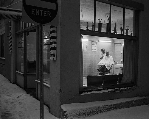 fuckyeahvintage-retro:  Barbershop exterior. Flagstaff, AZ (1979) © John Vink  I'm not sure if it's the trophies or the snow that really make the image. Maybe it's both.