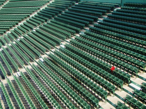 The red seat marks the furthest ball hit at Fenway Park.  They know this because it hit the guy sitting there in the head. ouch.