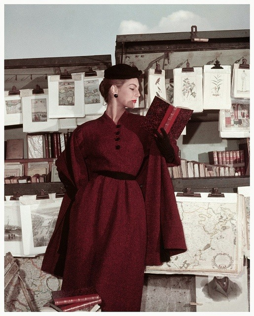 theniftyfifties:  Fiona Campbell-Walter at the Bouquinistes for the Elle winter collection, Paris 1953.