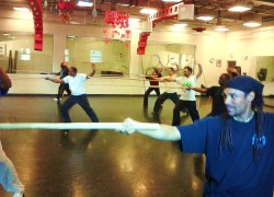 Terence Nicholson training Wudang Longmen Disciples in the basic Xingyi Long Staff form.