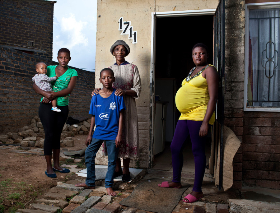 Mary Mokhethoa,68, with her three orphan grandchildren Itumeleng, 12, Dikeledi, 20, Lebogang, 22, and her great-granddaughter, Keamogetswe. Alexandra township, Johannesburg, South Africa; October 2012. Jonathan Torgovnik's photographs put a face on the destructive legacy AIDS has brought upon the families of South Africa. See more on LightBox.