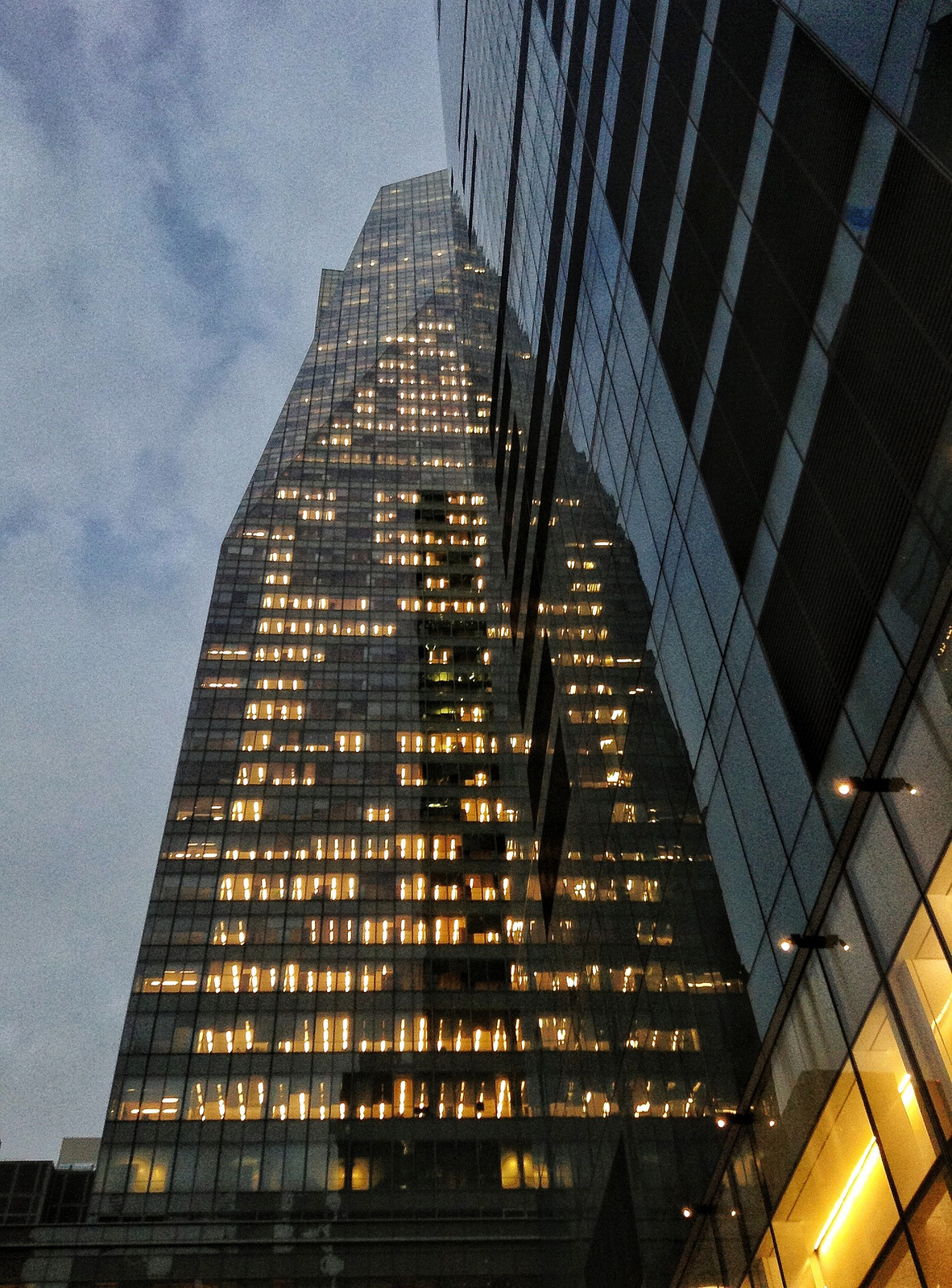 eyeheartnewyork:  The Bank of America building reflecting against the Met Life building