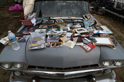 MATTERS OF IMPORT  Old photographs are laid out to dry on a car hood after being removed from a home flooded by superstorm Sandy in Seaside Heights, NJ.  (Photo: Mark Wilson / Getty Images via The Guardian)