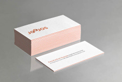 These quadruplexed business cards have a great pop of orange color in the center.