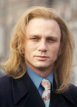 collegehumor:  Actual Picture of Long-Haired 90's Daniel Craig  Who's YOUR favorite Bond Girl?