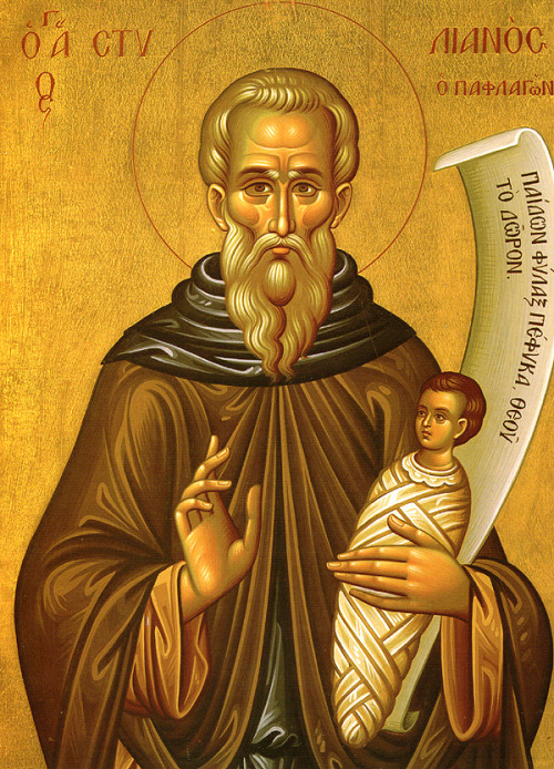 Today, the Orthodox Church commemorates beloved Saint Stylianos of Paphlagonia, the Patron Saint of Children, both born and unborn, and Orphans. Saint Stylianus was born in Paphlagonia of Asia Minor sometime between the fourth and sixth centuries. He inherited a great fortune from his parents when they died, but he did not keep it. He gave it away to the poor according to their need, desiring to help those who were less fortunate. Stylianus left the city and went to a monastery, where he devoted his life to God. Since he was more zealous and devout than the other monks, he provoked their jealousy and had to leave. He left the monastery to live alone in a cave in the wilderness, where he spent his time in prayer and fasting. The goodness and piety of the saint soon became evident to the inhabitants of Paphlagonia, and they sought him out to hear his teaching, or to be cured by him. Many were healed of physical and mental illnesses by his prayers. St. Stylianus was known for his love of children, and he would heal them of their infirmities. Even after his death, the citizens of Paphlagonia believed that he could cure their children. Whenever a child became sick, an icon of St Stylianus was painted and was hung over the child's bed. At the hour of his death, the face of St. Stylianus suddenly became radiant, and an angel appeared to receive his soul. Known as a protector of children, St. Stylianus is depicted in iconography holding an infant in his arms. Pious Christians ask him to help and protect their children, and childless women entreat his intercession so that they might have children. Please beloved Saint Stylianos, pray to God for us the sinners!
