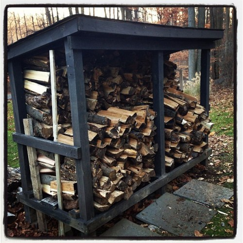 Husband spent the morning splitting wood, then we stacked it. Now having cider & a sammie in front of the fire.