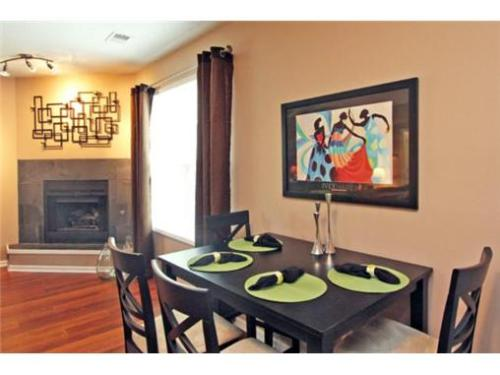 Cool Interior of a Townhome for sale in KCMO. I love the lime green barstools and accents.