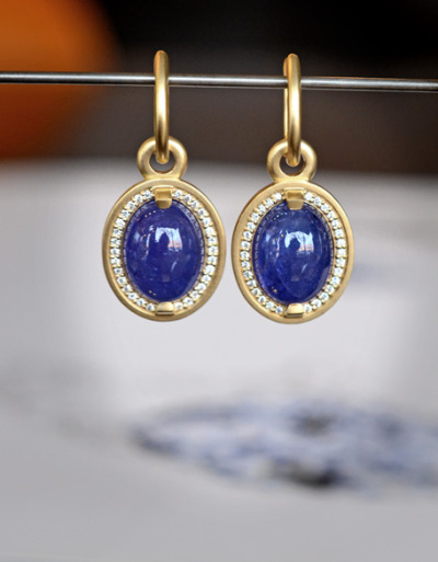 J ALBRECHT DESIGNS earrings in 18k with 13.5ctw cabochon tanzanites & .30 ctw diamonds.