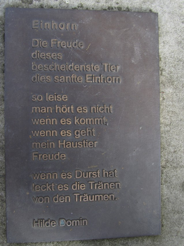 This is a poem about a unicorn. In German. Next to a statue of a Unicorn. That I sat on. Translation: Unicorn the joythishumblest animalThis gentle unicornso quietit is not hoardingwhen it comeswhen it goesmy petjoyif it has thirstit licks the woundsof the traumasby Hilde Domin