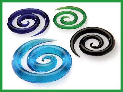 "Super Spirals! A Gorilla Glass classic. These guys come in an array of colours up to 0g and are available in Crystal all the way up to 3/4"" for those who really want to make a statement! These can be worn to size or a smaller gauge spiralled twice through large stretched lobes. Have your piercer get in touch! sales@getgorilla.com"