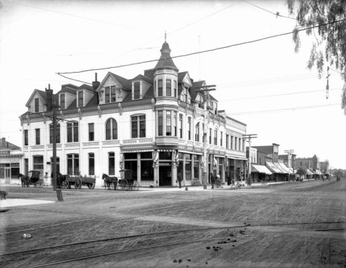 Corner of Third Street and Santa Monica Boulevard (then named Oregon Avenue) in Santa Monica, circa 1900. Today the intersection is part of the popular Third Street Promenade retail district. Part of the California Historical Society Collection in the USC Digital Library.