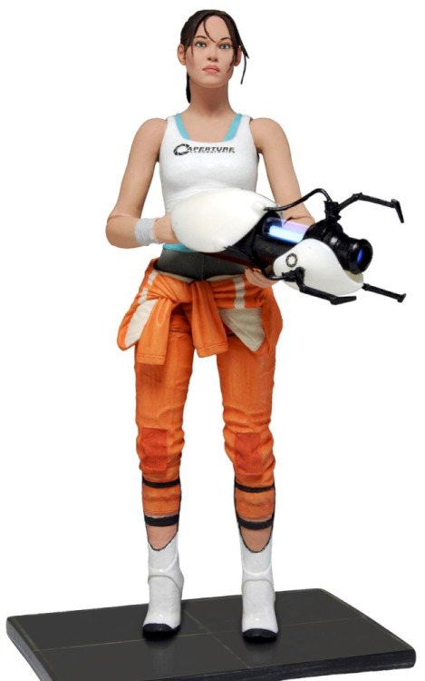 Chell Action Figure now available for pre-order from ToyWiz.com! From ToyWiz.com:  Name: Chell with Light-Up Portal Gun Manufacturer: NECA Series: Portal 2 Release Date: February 2013 For ages: 4 and up Details (Description): The most wanted and requested Valve figure is finally a reality. The protagonist Chell comes highly detailed in her orange Aperture Laboratories Jumpsuit. Chell is fully poseable with over 20 points of articulation and a display base. Articulation includes ball jointed neck, shoulders, torso and wrists along with insert molded ball hinged elbows and knees and more. Even more impressive is her ASHPD accessory which actually lights up and glows blue just like in the game and as seen in the full size ASHPD prop replicas.  Limited to 15,000 pieces!
