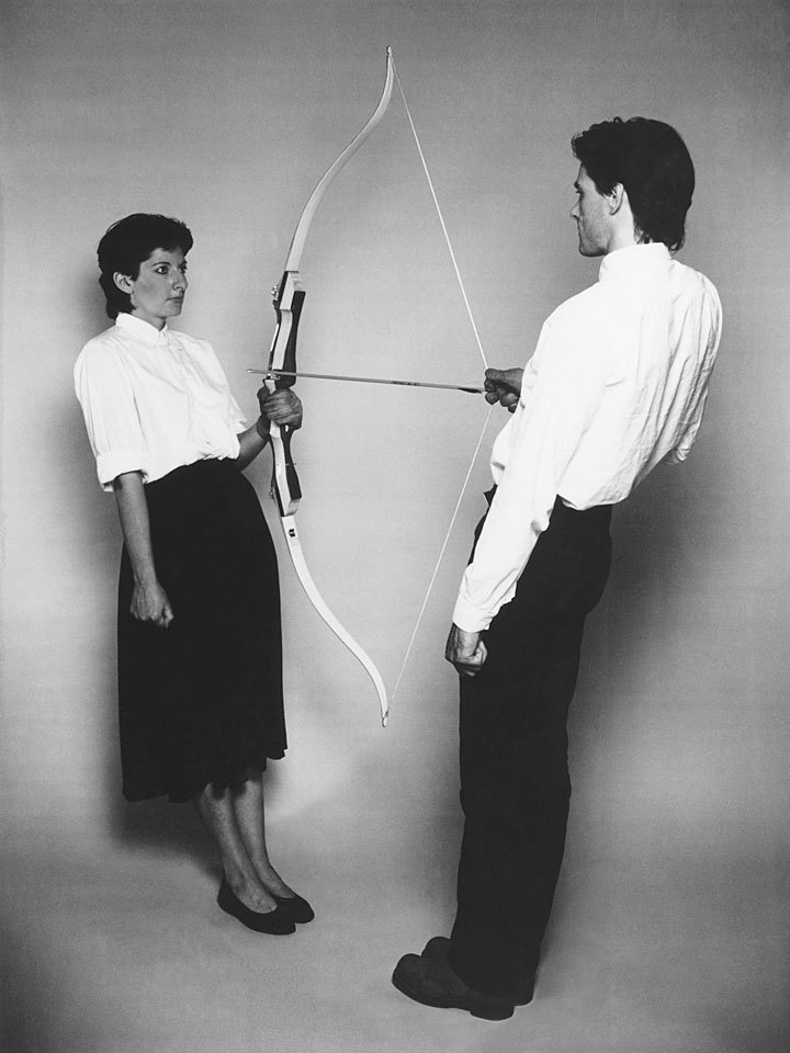 "showslow:  Marina Abramović and Ulay, Rest Energy (1980)   ""Together we held a taut bow and a poised arrow. The weight of our bodies put tension on the bow while the arrow pointed at Marina's heart. Small micophones were attached to both of our hearts, recording the increasing number of our heartbeats.""    Balls."