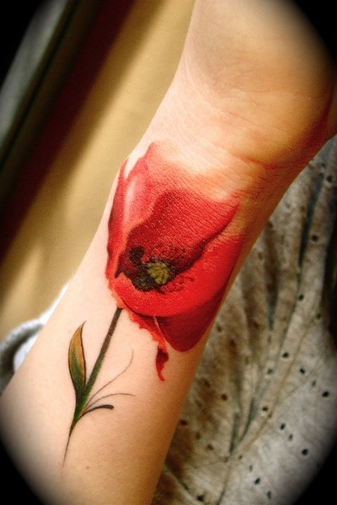 reaill:  permawkward:  watercolor floral tattoos  oh man this is great