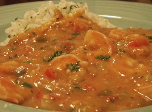 oooeygooeygoodness:  Shrimp Etouffee  Ingredients:5 lbs shrimp, peeled and chopped1 cup butter2 onions, chopped6 stalks celery, chopped3 tbsp garlic, finely chopped4 tbsp flour1 cup mushrooms, chopped 3 tbsp paprika 1 tsp cayenne pepper1 tsp red pepper flakes salt and pepper to taste Directions: In a large skillet melt butter. Saute onions, celery, and garlic. Stir in flour and cook slowly for 5 minutes. Add shrimp and cook for 20 minutes. Add 2-3 cups of water and mushrooms. Stir in paprika and seasoning. Cook for 30 minutes. Serve over rice with hot french bread. Season with file.  Source: Mine!!!  Note: A cajun favorite. Can also use crawfish instead or with the shrimp. I sometimes add andouille sausage to this recipe.