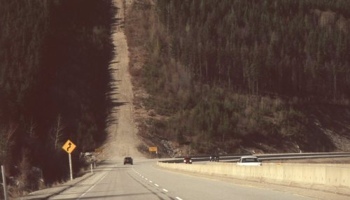 thebradford:  downhill Slide Film - Pentax k1000  this photo is backwards, but it's one of my favourite highway places.