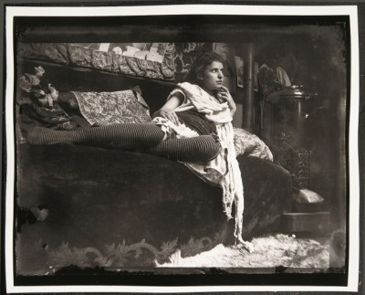 berryflavoredfresca:  Model reclining on the couch in Mucha's studio, Rue du Val-de-Grâce, Paris. (1899)