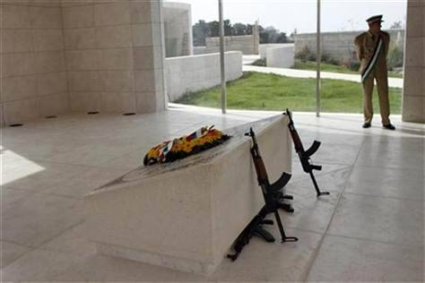 Remains of Yasser Arafat exhumed AP: Experts exhumed the grave of the former Palestinian leader Yasser Arafat on Tuesday in a bid to find out more about his death. A new investigation was sparked into Arafat's death earlier this year after a trace of a fatal radioactive substance was found on his clothing.  Arafat died in a French military hospital in November 2004 after abruptly falling ill only a month prior. Palestinian officials claim that Arafat was poisoned by Israel. Photo: A member of the Palestinian Presidential guard stands beside the grave of late leader Yasser Arafat in the West Bank city of Ramallah on October 24, 2012. (Mohamad Torokman / REUTERS)