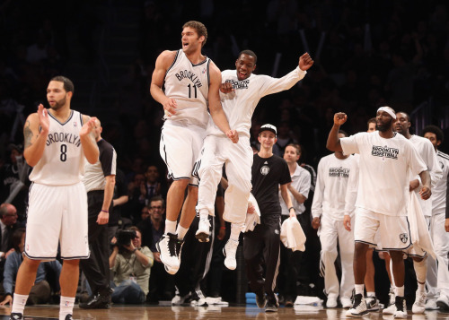 nba:  Tyshawn Taylor of the Brooklyn Nets bumps Brook Lopez #11 following Lopez's bucket late in the fourth quarter against the New York Knicks at the Barclays Center on November 26, 2012 in the Brooklyn borough of New York City. (Photo by Bruce Bennett/Getty Images)  The most action Tyshawn has seen. COACH, PUT THE BOY IN!
