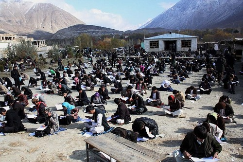 politics-war:  Afghan university students attend an exam in Baharak district in Badakhshan province on November 25, 2012. Afghanistan has closed down three major public universities in the capital Kabul for more than a week after sectarian clashes left one student dead and nearly 30 others wounded, an official said. Photo: Sharif Shayeq