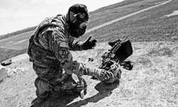 usarmystrong:  United States Army - Lt. Col. Jayson Allen dons his gas mask for the chemical environment portion of the qualification at the M-4 rifle range at Camp Atterbury.