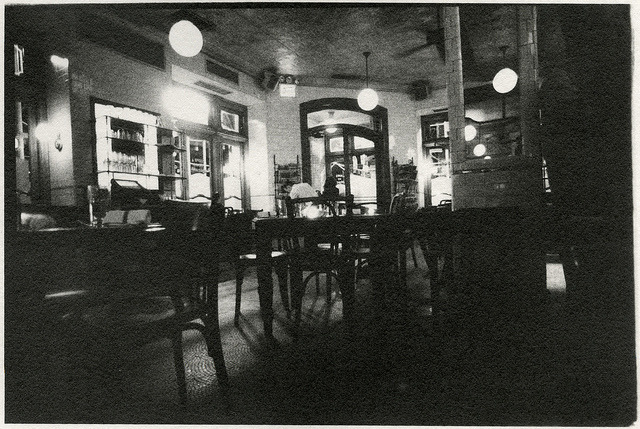 PASTIS, 4 AM, CLOSING by CHRISTOPHER LANGE Back in the summer time I used to go into Pastis at closing time to chat with Joe and Teddy before going home. They'd lock the doors and have a bite to eat, and I'd have a glass of Côtes du Rhône on the house. We would talk for about half an hour or so in the empty restaurant, and it always felt a bit surreal because during business hours the place is constantly packed.  Sitting at the end of the bar, looking over the vacant tables which had been abuzz with conversation and inebriation only an hour earlier only made it seem that much more silent.