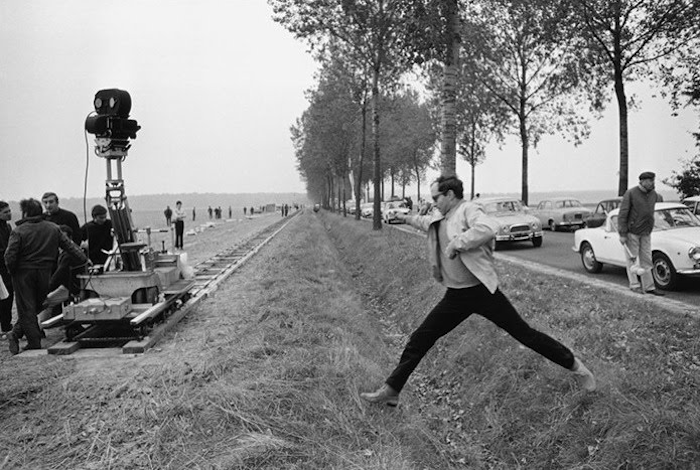 tmaction:  Godard on the set of Weekend, September 1967. Photo by Gilles Caron. Hey internet people, you should ask your assistant to make time in your busy schedule to watch Weekend. You'll need 105 minutes. If that's too long maybe they could just explain the gist of it to you, and one scene in detail so you can talk about it loudly and impress the shit out of people while you're waiting in line to see something at MIFF.
