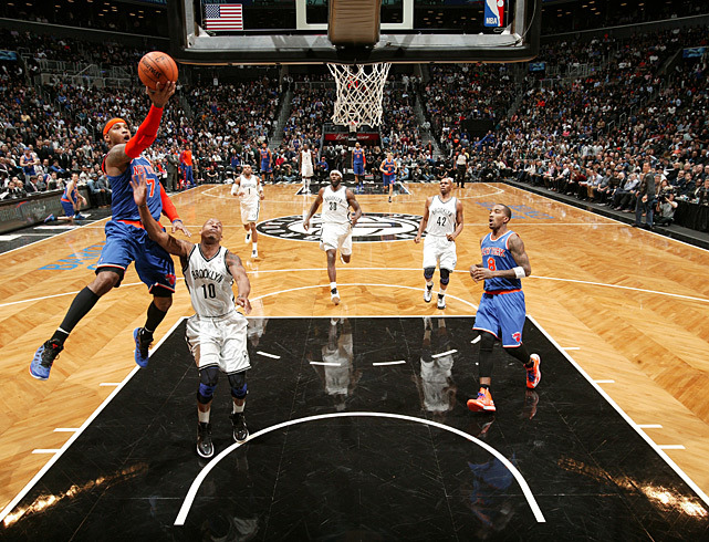 Carmelo Anthony swoops in for a layup during Monday's New York City matchup of the Knicks and Nets. Anthony scored 34 points but the Nets prevailed in overtime 96-89. (Nathaniel S. Butler/NBAE via Getty Images) MANNIX: Nets win battle, but still have a long way to go