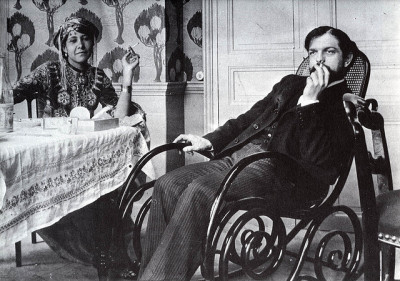 "Debussy with Zohra ben Brahim, 1897, at the house of their friend the erotic poet and photographer Pierre Louÿs. Louÿs brought Zohra to Paris from Algeria as a kind of muse, and, well… ""We are stuck together like two dogs in the street,"" he had written to Debussy."