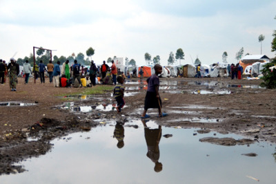 "Photo: Refugees in Kanyaruchinya, where thousands of people displaced by violence have settled. DRC 2012 © Aurelie Baumel/MSF DRC: ""These People are Completely Dispossessed""An interview with our head of mission in the Democratic Republic of Congo, where panic and fear in the wake of an advance by rebels on Goma is beginning to subside. What's the situation where you are? At the moment I'm in Rutshuru, the M23 stronghold, the eye of the cyclone. The situation right now is rather quiet. In Goma, things have been calming down slowly since the fighting ended and the gunfire has stopped. Yesterday there were about 100 wounded, both civilians and military actors; their wounds mostly from gunfire and shrapnel. The exact number of dead is still unknown but there are bodies in the streets. People remain fearful and the shops are still all closed, and there's no electricity or water anymore. There's also a clear need for surgical support. A lot of people who were displaced in July during the fall of Rutshuru to the M23, and who settled on the edge of the city in Kanyaruchinya, have gone to Goma or westward to Sake. They say that more than 55,000 people are on the move. What are you seeing in the streets, the camps, the hospitals? Kanyaruchinya camp is empty. Since the fighting stopped, some people have come back up from the city to Rutshuru, their home turf. It's worth noting that these people are completely dispossessed—before this new wave of violence, the camp wasn't being maintained properly, so people were already in a state of utter destitution. I imagine that very soon the shops will open up again and that the city will come back to life. But we are talking about a serious shock here, and trust and the general atmosphere will take a while to stabilize, all the more so as people are now talking about a counter-attack. What's MSF doing to respond to this emergency? We're putting a surgical support team in place in Goma, and we're also working with the displaced people. Today, we're able to work more or less as normal, but our teams are of course stressed out and worried. This is literally a regime change—how's the city going to function tomorrow? The International Committee of the Red Cross has also got a surgical team here, but a lot of organizations have evacuated so it's a matter of waiting for them to return. Of course, we're not waiting—we're working! The health facilities are still working, so MSF isn't there to take care of all needs but rather to provide support. As concerns the displaced, the situation should be monitored closely, as we're seeing some come back to Rutshuru rather than resettling in Kanyaruchinya. Something to keep an eye on. What are the most significant challenges for you as MSF? The most difficult thing is getting expatriate staff to Goma as the context is changing quickly. The logistical constraints to reaching certain areas can also complicate our efforts to size up needs or set up activities. For example we wanted to get to certain displaced camps by going round the lake by way of Bukavu, but that's not possible for the moment. The most important thing for us is still the security of MSF staff and of the patients."