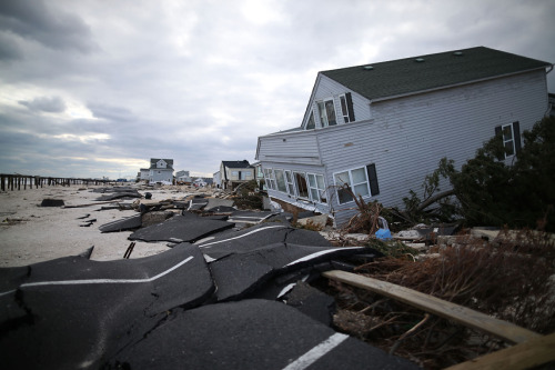 Photo of the day: Seaside Heights picks up the pieces nearly a month after SandyDamaged homes, asphalt and other debris are strewn along the shore of Ortley Beach, N.J. on Nov. 24 — nearly a month after Sandy led a rampage through the region. Properties remain off limits to owners and residents.See more Hurricane Sandy photos.