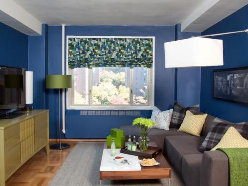 "Small Living Room Decorating Ideas - this is an article from HGTV:   http://tinyurl.com/7rdclxm   on how to make a small room look great.  When you are getting ready to sell your home - simple inexpensive improvements can make a big difference.  ""As far as color is concerned, the Ardens are happy with their designer's advice to choose a dark hue for the walls in their small space. Jodi initially assumed dark colors would instantly make the small space even smaller; however, she's thrilled with the overall effect, stating: ""Believe it or not, the peacock blue on the walls makes the room feel larger. It's almost like the dark blue walls fall back and let the furniture and bold apple green jolts of color take center stage."" All three zones carry the blue tone through accents, including the graphic art and a shag area rug in the formal dining area as well as baskets and accents in the office."