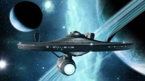 "INTO DARKNESS! The strangely-titled ""Star Trek"" sequel, ""Star Trek Into Darkness"" gets officially synopsized. Via Badass Digest:   In Summer 2013, pioneering director J.J. Abrams will deliver an explosive action thriller that takes Star Trek Into Darkness. When the crew of the Enterprise is called back home, they find an unstoppable force of terror from within their own organization has detonated the fleet and everything it stands for, leaving our world in a state of crisis. With a personal score to settle, Captain Kirk leads a manhunt to a war-zone world to capture a one man weapon of mass destruction. As our heroes are propelled into an epic chess game of life and death, love will be challenged, friendships will be torn apart, and sacrifices must be made for the only family Kirk has left: his crew. (via MTV Geek - The Daily Geek: 'Star Trek' Synopsis, 'Iron Man 3' News, Linnea Quigley's Horror Workout And More)"