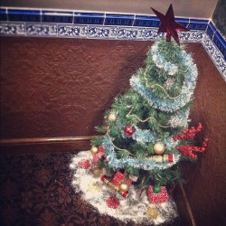 Best pub decorations ever. Crappy tree and spray snow in corner of stairs.  (at Blue Anchor)