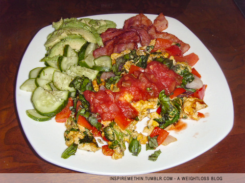 Breakfast: 3 eggs, 3 strips bacon, spinach, red pepper, red onion, basil, salsa, 1/2 avocado, cucumber. Coffee w/ butter & heavy cream and a dash of pumpkin pie spice mix. :3 nom!