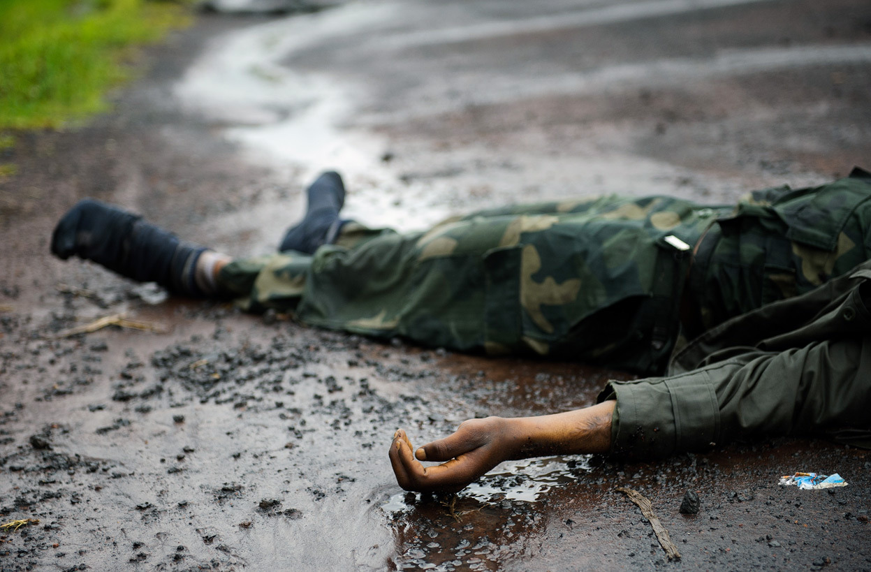 From Rebel Attacks in Eastern Congo, one of 37 photos. The body of a dead Congolese army soldier lies in the road between Goma and Kibati, in eastern Democratic Republic of the Congo, on November 18, 2012. Government soldiers were fleeing the eastern DR Congo city of Goma in large numbers today as rebels advanced to the gates of the regional capital, a UN source said. Rebels took control of Goma two days later. (Phil Moore/AFP/Getty Images)