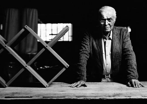"L'uomo che Firma il Legno A rare look inside the studio of master woodworker Pierluigi Ghianda  by Paolo Ferrarini in Design on 27 November 2012   Pierluigi Ghianda, known to many as the ""poet of wood,"" has in his career left an indelible mark on the world of design. The master ebonist was born in Brianza, a region that is considered the real factory of the Milanese design—if Milan can be considered the head, Brianza is the hand. His experience in craftsmanship was pivotal for the success of products by Gae Auelnti, the Castiglioni brothers, Ettore Sottsass, Massimo Vignelli, Bob Noorda and Aldo Cibic, just to name a few. Recognized among his peers for an innate ability to understand wood, Ghianda is a master of realizing simple but unexpected solutions to apparently impossible design conundrums. Italian design firm Studiolabo has spent the last few years filming Ghianda at work in his unique laboratory for the documentary entitled ""L'uomo che firma il legno."" Translated to ""The man who signs wood,"" the film aims its lens at Ghianda's breathtaking skill, as well as his traditional practices in serious risk of disappearing. To learn more we caught up with Studiolabo founder and the documentary's screenwriter, Cristian Confalonieri. How did you meet Pierluigi Ghianda? I was born in Seveso, in the heart of Brianza. In the postwar years, this area had the highest density of carpentry in Italy, and, I assume, beyond Italy. In this area of high craftsmanship even large design firms were born—those that helped create what we know as ""Made in Italy"". In this context Pierluigi Ghianda is considered the master. We were lucky—the father of my copartner Paolo has worked in the Ghianda workshop for many years and officially introduced us to Pierluigi. How was this film born? Each year Studiolabo invests some spare time (very little, thankfully!) in a cultural project. After getting in contact with Pierluigi we embarked on the journey of making the film that took us from childhood in Brianza to the true passion for design that defined his adulthood. We agreed that we had a moral obligation to introduce the world to Pierluigi Ghianda, a craftsman who has spent his life studying, manipulating, playing with one material—wood. A man of great charisma that has attracted the best Italian and international designers, becoming a designer himself, with an approach to work and life that today is obsolete but from which we can only learn. Thanks to our dear friend Patrizio Saccò, a very good director of photography, we were able to experiment with the language of the documentary, which we felt was the best way to represent the world around the Ghianda workshop. Is this the beginning of a project or a unique case? We would like this to be just the beginning of a larger film project. The theme is that of manual labor, not seen with nostalgia but as the origin of design, a patrimony of knowledge to be disseminated. The craftsman does not know how to communicate what he does, he just does it. We would like to get immersed in the passions of these men and to create a dialogue around the aspects of production that often remain hidden in the substrate of the creative process. The next project, on which we are already working, will address the theme of the movable type printing today and its re-interpretations with digital. Given your experience in the design field, what do you think is the role of artisans in the future of the industry? Craftsmen as we know them are older people and probably their trades will end when they stop working. The craftsman is a man, a knowledge, a belief, a way of life. Is not transmissible to posterity as simple know-how, is deeply linked to the roots of the people and places. Design, like any creative process, cannot exist without the production component. Also, industrial production cannot exist without the prototypes, the prototypes cannot exist without a hand that creates it, the hand cannot exist without the gesture. And that gesture is the craftsmanship—a gesture that is never equal to itself because it is always trying to improve. And this is the role of the artisan-craftsman, even though the model of the 1950s to 1970s cannot exist anymore. Today there is a new nebula of craftsmanship made of makers, self-producers and prosumers, which is struggling to gain consistency. It seems like if the need for craftsmanship is obvious but still not able to be channeled into something concrete or able to be reproduced. I hope for a future in which the craft will be knowledge and no longer a dumb know-how. Contact Studiolabo directly to order the documentary. Images by Giancarlo Pradelli   via Cool Hunting"