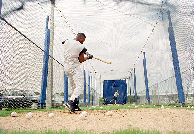 Chicago White Sox outfielder Bo Jackson takes batting practice from coach Tommy Thompson at the team's spring training facility in Sarasota, Fla. in Feb. 1992. (AP Photo/Eric Gay) SI VAULT: Bo becoming baseball's most exciting player (6.12.89)